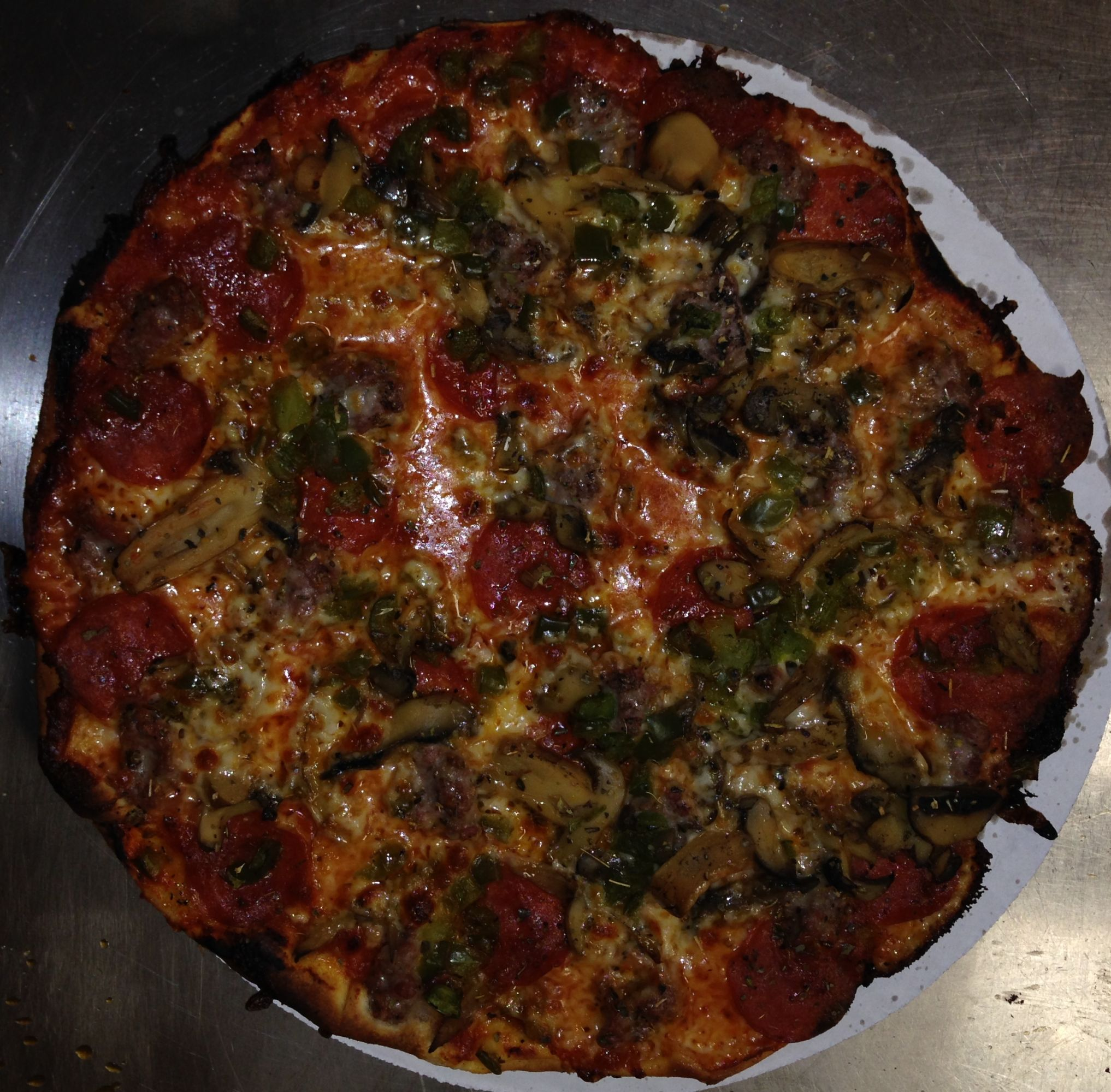 Fricanos EBA Everything But Anchovies, Pepperoni, Italian Sausage, Mushroom & Green Pepper Pizza Pie 2.jpg